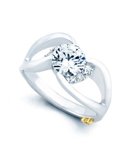 The Rendezvous engagement ring contains 7 diamonds, totaling 0.065ctw. Center stone sold separately, not included in price. Available in yellow, white, or rose gold, and platinum. Rings can be custom made to fit any size or shape diamond or color center stone. Price excludes center stone