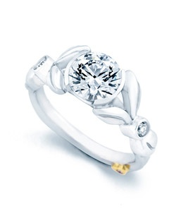 The Resplendent engagement ring contains 3 diamonds, totaling 0.065ctw. Center stone sold separately, not included in price. Available in yellow, white, or rose gold, and platinum. Rings can be custom made to fit any size or shape diamond or color center stone. Price excludes center stone