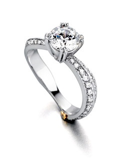 The Starlight engagement ring contains 61 diamonds, totaling 0.44ctw. Center stone sold separately, not included in price. Available in yellow, white, or rose gold, and platinum. Rings can be custom made to fit any size or shape diamond or color center stone. Price excludes center stone