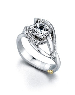 The Swept Away engagement ring contains 31 diamonds, totaling 0.13ctw. Center stone sold separately, not included in price. Available in yellow, white, or rose gold, and platinum. Rings can be custom made to fit any size or shape diamond or color center stone. Price excludes center stone