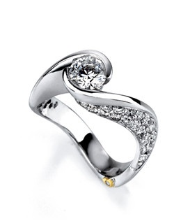 The Ultimate engagement ring contains 50 diamonds, totaling 0.925ctw. Center stone sold separately, not included in price. Available in yellow, white, or rose gold, and platinum. Rings can be custom made to fit any size or shape diamond or color center stone. Price excludes center stone