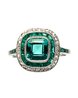 Breckenridge is a stunning vintage-inspired platinum, emerald and diamond ring that is a personal favorite of the T&H team! Centering a bezel set 1.64ct Cushion Cut emerald, this ring is accompanied with a GIA Certificate stating the beautiful emerald is of Colombian origin with minor clarity enhancements (F1). The center stone is the perfect emerald green color and has no visible inclusions to the naked eye, which is incredibly rare for an emerald! Breckenridge is surrounded by a halo of eighteen Calibre Cut emeralds and thirty Rose Cut diamonds, finished off with four Rectangular Cut emeralds on the shoulders of the ring. Breckenridge is currently a size 6.5 and can be sized to fit most ring sizes.