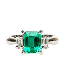 Sagebrook is a chic, platinum-set emerald and diamond engagement ring featuring a 1.76ct Step Cut Rectangular emerald. This stunning emerald is accompanied by a Guild Laboratory certificate stating that the emerald is of Colombian origin with minor clarity enhancement. Two prong set Emerald Cut diamonds flank either side, totaling exactly 0.43ct graded F-G color and VS clarity. This classic three stone design is sure to impress! Sagebrook is currently a size 6 and can be sized to fit.