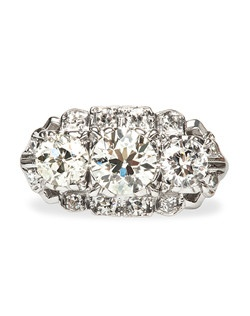 Noblesville is a showstopping late Art Deco era 14k white gold ring centering a 0.82ct EGL Certified Old European Cut diamond graded I color and VS1 clarity, flanked on either side by two Old European Cut diamonds totaling approximately 0.65ct and graded I-J color and VS clarity. Noblesville is further enhanced by a delicate frame of twelve Single Cut diamonds totaling about 0.25ct. Noblesville is currently a size 4.75 and can be sized to fit.