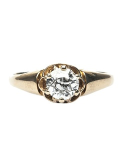 Oyster Bay is a charming Victorian era diamond ring made from 18k yellow gold centering a 0.62ct EGL certified Old European Cut diamond graded I color and SI1 clarity. This gleaming center diamond shines solo from a simple, six prong buttercup setting adorned only with a highly polished, softly rounded tapered ring shank. Oyster Bay is currently a size 5 and can be sized to fit.