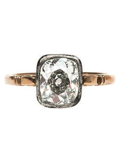 Petersburg is a simply elegant Russian Victorian era engagement ring made from silver topped 14k rose gold. Petersburg stars an incredible 2.06ct EGL certified Old Mine Brilliant Cut diamond graded G color and SI1 clarity, which rests upon an embellished basket adorned with scrolling filigree. Petersburg's shank features Russian hallmarks that date back to the late 1800's during the reign of Tsar Alexander III and the height of the Russian bourgeoisie. Petersburg is currently a size 7 and can be sized to fit.