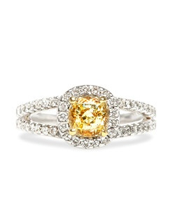 Annapolis is a contemporary halo engagement ring made from 14k white gold centering a 0.54ct GIA certified Fancy Yellow diamond with VS1 clarity. This gorgeous yellow diamond is perfectly nestled within a halo of bright white micro pavé set diamonds supported by matching delicate split shoulders totaling 0.60cts in diamond weight. Annapolis is currently a size 6.5 and can be sized to fit.