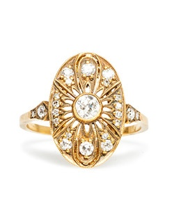 Peachtree II is a gorgeous vintage-inspired Edwardian style engagement ring made from 18k yellow gold featuring a bezel set Old European cut diamond weighing exactly 0.21ct, graded G-H color and VS2 clarity. This sparkly diamond is surrounded by a light and airy oval motif encrusted with bead set antique Single Cut round diamonds totaling approximately 0.17ct. Delicate milgrained edges around the intricate setting are placed throughout this navette cocktail ring.