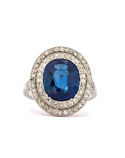 Provence is a stunning Belle Epoch ring featuring a GIA certified 4.85ct natural, unheated oval sapphire accented with pave set Single Cut diamonds with a total approximate weight of .60ct., graded H-I color and SI clarity, set in platinum. This exceptional sapphire ring has clear French hallmarks and is numbered as well. Circa 1900. This ring can be sized to fit.