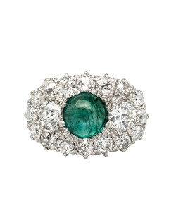Green Brier is a lovely Victorian era platinum topped 14k yellow gold cluster ring centering a beautiful pale green, natural cabochon emerald surrounded by a gleaming halo of sixteen Old European Cut diamonds totaling aproximately 1.40cts in weight, graded H-I color and SI clarity. Green Brier is completed with a simple 14k yellow gold shank with a beautiful antique patina. Green Brier is currently a size 5.5 and can be sized to fit.