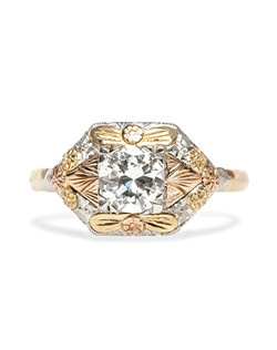 Trumpet & Horn's exclusive Carver ring is a design based on a beautifully crafted Retro era diamond ring made from platinum, 18k yellow and rose gold centering an EGL certified diamond. This unique ring uses a unique tricolor mixed metal combination that wonderfully highlights the bright center diamond. This ring can bemade to order.