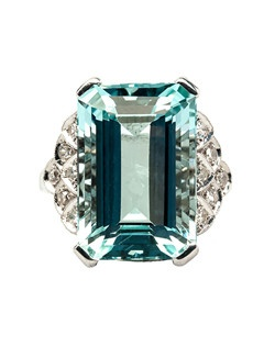 Valley Falls is a show-stopping late Art Deco era platinum set cocktail ring centering a stunning 10.26ct Retangular Step Cut natural aquamarine. Flanked on either side by decadent, scalloped stepped-down shoulders and studded with twelve Single Cut diamonds totaling approximately 0.12ct., Valley Falls is sure to make a statement wherever she goes! This ring is currently a size 6 and can be sized to fit.
