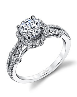 A halo and split band of shimmering diamonds elegantly present a brilliant center stone. Available in platinum, 18K white, 18K yellow, or 18K rose gold. All Parade Design styles can be customized upon request.$2,075 in 18K,$3,075 in platinum. Price excludes center stone.