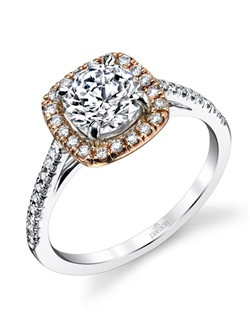 Parade's classic cushion halo engagement ring with a touch of glowing rose gold. Available in platinum, 18K white, 18K yellow, or 18K rose gold. All Parade Design styles can be customized upon request.$2,150 IN 18k, $3,000 in platinum. Price excludes center stone.