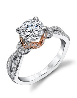 A brilliant-cut diamond is set in the midst of sparkling diamonds that crisscross and curl creating a playful yet chic two-toned look from the Hemera Collection.$3,150 in 18K, $4,650 in platinum. Price excludes center stone.