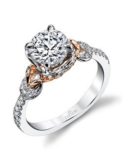 Diamond-set rose gold curls beneath a round brilliant-cut diamond. This two-toned engagement ring from the Hemera Collection offers a modern look with classic appeal.  Available in platinum, 18K white, 18K yellow, or 18K rose gold. All Parade Design styles can be customized upon request. $2,375 in 18K, $3,725 in platinum. Price excludes center stone.