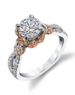 A brilliant-cut diamond is set in the midst of sparkling diamonds that crisscross and curl creating a playful yet chic two-toned look from the Hemera Collection. $2,925 in 18K, $4,250 in platinum. Price excludes center stone.