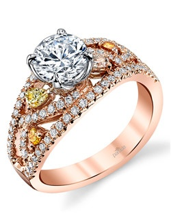 Parade's LYRIA Signature Crown sits atop a sculpted band of 18K rose gold and 0.58 carats of colorless and fancy color diamonds! Available in platinum, 18K white, 18K yellow, or 18K rose gold. All Parade Design styles can be customized upon request. $3,950 in 18K, $5,525 in platinum. Price excludes center stone.