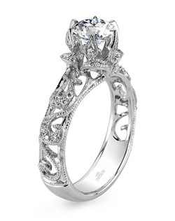 Parade's vintage-inspired design from the Hera Collection is anything but your basic engagement ring as milgrain etched scrolls curl and climb toward a brilliant-cut diamond. $2,675 in 18K, $4,375 in platinum. Price excludes center stone.