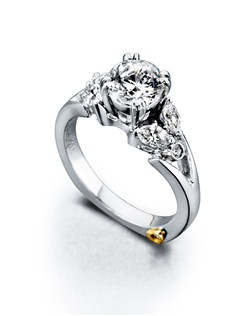 The Divine engagement ring contains 6 diamonds, totaling 0.45 ctw. Center stone sold separately, not included in price. Available in yellow, white, or rose gold, and platinum. Rings can be custom made to fit any size or shape diamond or color center stone. Price excludes center stone