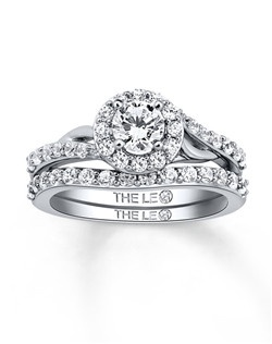 The center diamond is independently certified and laser-inscribed with a unique Gemscribe® serial number. The bridal set is styled in 14K white gold and has a total diamond weight of 1 carat. Diamond Total Carat Weight may range from .95 - 1.11 carats.