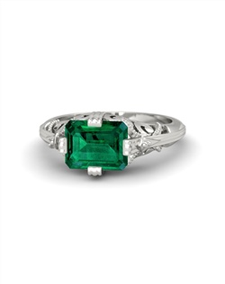 Lovely scrolled forms embrace a dramatic emerald-cut gemstone in this stunning vintage-inspired design. Customize with your choice of 22 gemstones and 9 precious metals.
