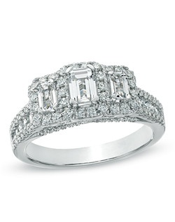 Make the moment magical with this exquisite diamond engagement ring. Expertly crafted in 14K white gold, this ring showcases a 3/8 ct. emerald-cut certified diamond center stone, boasting a color rank of H-I and clarity of SI2-I1. Smaller emerald-cut diamonds flank this center stone, and each diamond is bordered with a frame of smaller round accent diamonds. Additional accent diamonds line the double shank, completing this eye-catching style. Designed to take her breath away, this ring captivates with 1-1/2 cts. t.w. of diamonds and a polished shine. The ring arrives with a certificate that includes a photo and a description of the diamonds, which guarantees quality and can be used for insurance purposes. Price includes center stone and setting.