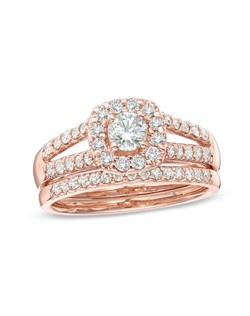 Honor the woman you adore with this exquisite diamond bridal set. Fashioned in 14K rose gold, the engagement ring showcases a stunning 1/3 ct. round diamond center stone bordered with a cushion-shaped frame of smaller round accent diamonds. Additional round accent diamonds line the ring's split shank. On your wedding day, the coordinating diamond wedding band completes this elegant ensemble. Radiant with 1 ct. t.w. of diamonds and finished with a polished shine, this bridal set is a breath-taking and beautiful beginning to your eternal love story. Price includes center stone and setting.