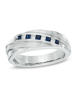 On your wedding day, pledge to love, honor and cherish him with this handsome sapphire and diamond band from the Vera Wang LOVE Collection. Created in cool 14K white gold, this ring features a series of alternating princess-cut diamonds and blue sapphires arranged on the diagonal across a cleverly overlapping band. Bold, unique and as handsome as he is, this ring captivates with 1/6 ct. t.w. of diamonds and a polished shine. The Vera Wang LOVE Collection is available exclusively at Zales. Price includes center stone and setting.