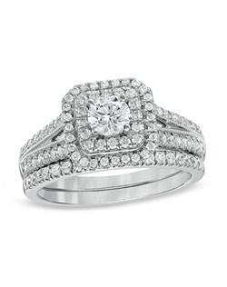 All of love's most precious moments shine through this romantic bridal set. Expertly cut to be visually larger, the Celebration Grand® is a diamond that shines bigger and bolder than one of the same carat weight. Fashioned in 14K white gold, the engagement ring features a breathtaking master-cut 3/8 ct. certified diamond, boasting a color rank of I-J and clarity of I1. Round accent diamonds create a double frame around the center stone and line the polished split shank. On your wedding day, the coordinating diamond wedding band completes the ensemble. Radiant with 1 ct. t.w. of diamonds, this bridal set will sparkle for a lifetime. This set arrives with a certificate that includes a photo and description of the diamond, which guarantees quality and can be used for insurance purposes. Price includes center stone and setting.