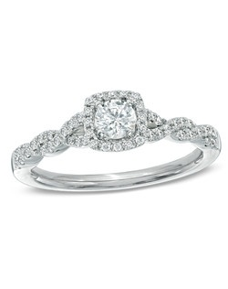 Take her breath away with this absolutely stunning diamond engagement ring. Fashioned in 14K white gold, this ring showcases a magnificent Celebration Fire® 1/4 ct. certified diamond center stone, boasting a color rank of H-I and clarity of SI1-SI2. Master craftsmen cut 71 precise facets that create a pattern of ten hearts and ten arrows on every Celebration Fire® diamond. This exceptional diamond is surrounded by a frame of smaller accent diamonds, which also line the ring's twisting shank. Radiant with 1/2 ct. t.w. of diamonds, this ring is finished with a polished shine. This ring arrives with a certificate that includes a photo and a description of the diamond. The certificate guarantees quality and can be used for insurance purposes. Price includes center stone and setting.