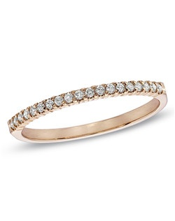 Honor your vows as you slip this enchanting 10K rose gold diamond wedding band on her finger, creating a moment the two of you will always treasure. From that special day forward, this ring will serve as a memory of that day and of your promise to love each other forever. Set with shimmering round diamonds totaling 1/6 ct., it's a thoughtful, polished look she'll adore.Price includes setting.