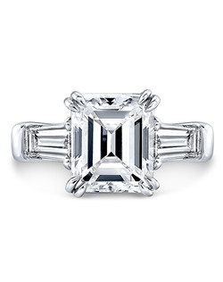 Emerald Cut diamond, 3.10 carats, tapered baguette side stones; total weight .90; platinum setting