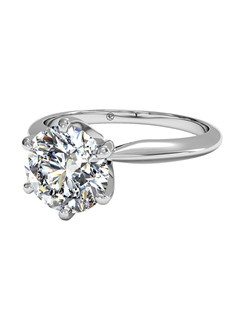 Solitaire Diamond Six-Prong Knife-Edge Band Engagement Ring in Platinum. Price excludes center stone.