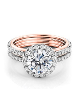 Platinum and rose gold setting with .45 tcw diamonds  in shank, center diamond not included