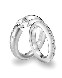 Steven Kretchmer platinum and diamond engagement ring with matching band.