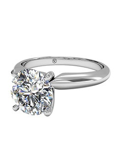 Round Cut Solitaire Diamond Knife-Edge Engagement Ring in 18kt White Gold. Price excludes center stone.