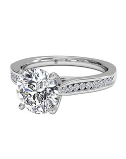 Round Cut Channel-Set Diamond Engagement Ring with Surprise Diamonds in 18kt White Gold (0.14 CTW). Price excludes center stone.