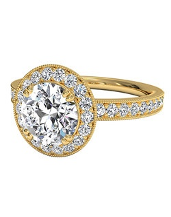 Vintage Round Cut Halo Diamond Engagement Ring with Surprise Diamonds in 18kt Yellow Gold (0.40 CTW). Price excludes center stone.