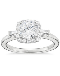 This strikingly sophisticated platinum engagement ring showcases your center diamond with a scintillating pavé-set diamond halo and two classic baguette-cut diamond accents. Price does not include center stone.
