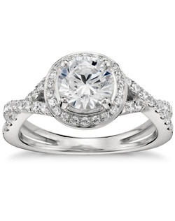 Lavishly curved and showcasing your center diamond with brilliance, this twist-shank halo engagement ring is crafted in enduring platinum with scintillating pavé set diamond accents. Price does not include center stone.