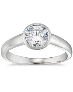 This modern platinum engagement ring will showcase the center diamond of your choice in a bezel-set setting. Zac infuses luxurious style by adorning each ring with a signature 18k yellow gold interior accent.Price does not include center stone.