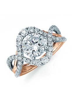 """A unique setting for your """"One and Only"""". Intersecting loops in white gold with pave diamonds dazzle along the round center stone with a white gold polish split tapered shank sitting below the center stone. Available in any size center and metal (center not included) 56 DIA 0.89 CT"""