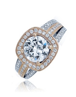"""""""This Sage ring will definitely make heads turn with its 2 carat center and micro-set diamonds on its cushion top and on its triple band. This creation is shown in pink gold top with white and pink gold split shank. Available in any size center and metal. (center not included) 80 DIA 0.45 CT"""""""