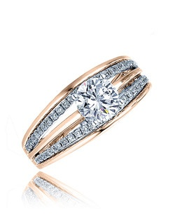 Honor your love with a ring that will take her breath away. This Sage ring has a round center stone on top of two lines of diamond bands in between three split polished bands that forms its shank. Available in any size center and metal. (center not included) 56 DIA 0.30 CT