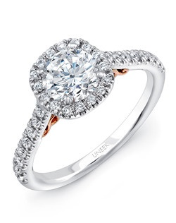"""Round diamond engagement ring with cushion-shaped halo, in 14K white gold, designed to fit 6.0 mm center, with 32 round brilliants U-pave set along the halo and halfway down the shank; this style features a dainty lotus flower-inspired filigree design in 14K rose gold cascading under the head, and two """"surprise diamonds"""" embedded in the filigree; this style can accommodate a range of center stone sizes (beginning at 0.50 carats), available by special order; this style can accommodate different center stone cuts, available by special order Price excludes center stone"""
