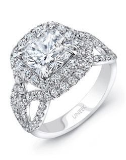 Lustrous cushion-shaped diamond double halo engagement ring in 18K white gold, designed to hold a 7.5 mm center in a double-claw setting, featuring 98 round brilliant cut diamonds (combined weight of 1.33 carats) U-pave set along the halos and down the upper shank; this style highlights a very elegant ribbon-like shoulder style, with three rows that curve charmingly: the two outer rows shooting downward and inward to support the gallery, and joining at the tips to form a delicate leaf-life shape, and the middle row shooting upward and splitting into a Y to form the ring's outer halo; from Uneek's Radiance Collection; this style can accommodate a range of center stone sizes (beginning at 0.50 carats), available by special order; this style can accommodate different center stone cuts, available by special order Price excludes center stone