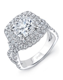 Majestic cushion-cut diamond double halo engagement ring in 18K white gold, designed to fit an 8.0 mm center in a double-claw setting, featuring 90 round brilliant cut diamonds (combined weight of 1.60 carats) U-pave set along the cushion-shaped halos, around the gallery, and halfway down the ribbon-like upper shank that is the hallmark of Uneek's Radiance Collection; two of the bigger round brilliants are prong set in each side of the head, for that extra sparkle; this style can accommodate a range of center stone sizes (beginning at 0.50 carats), available by special order; this style can accommodate different center stone cuts, available by special order. Price excludes center stone.