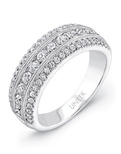 3-row pave wedding band in 14K white gold, featuring 12 round brilliants (combined weight of 0.63 carats) pave set along the middle row, and 46 smaller rounds (combined weight of 0.33 carats) pave set down the outer rows (23 rounds per side); the rows are separated by milgrain trim; designed as matching band to one of the best-selling ring styles from Uneek's Unity Collection
