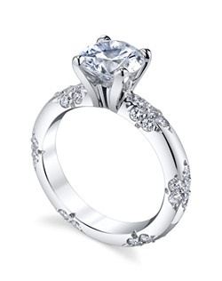 Inspired by the most exquisite French lace, the LACE Collection is for the delicate bride who appreciates the understated elegance and symmetry of the equally interspersed diamond bouquets. Price excludes center stone